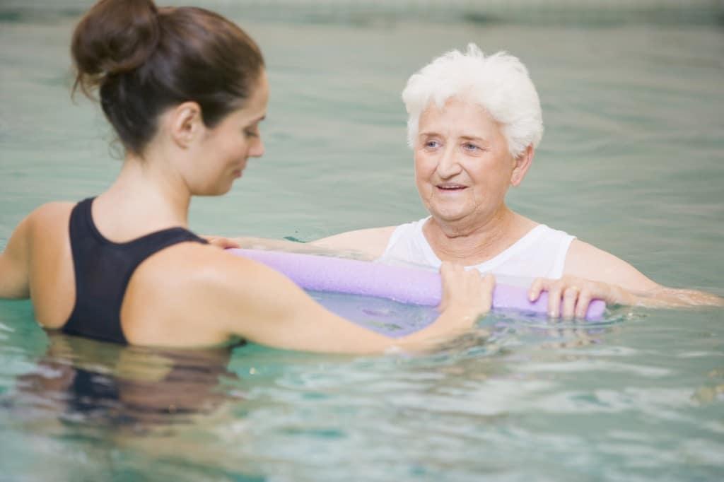 Instructor And Elderly Patient Undergoing Water Therapy